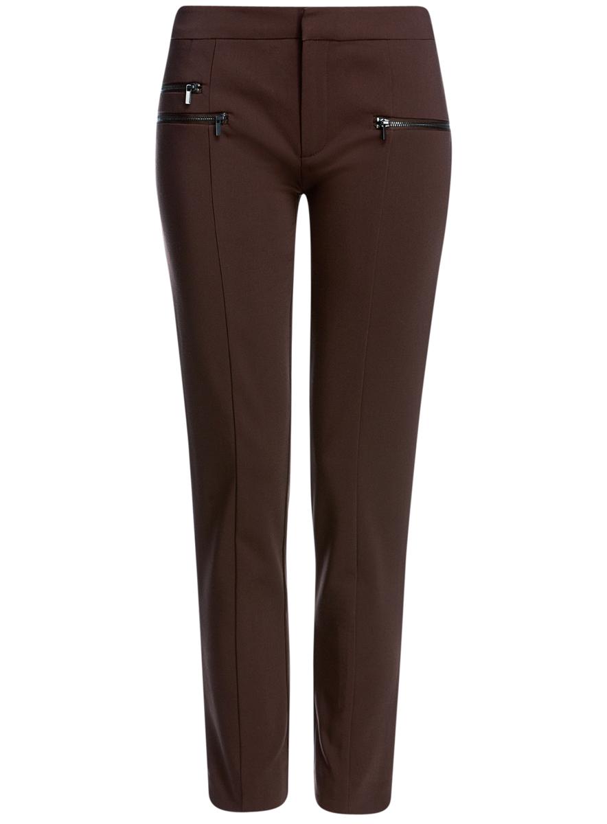 Брюки женские oodji Ultra, цвет: коричневый. 11706194/35589/3900N. Размер 44 (50-170)11706194/35589/3900NСтильные, немного укороченные женские брюки oodji Ultra выполнены из качественного комбинированного материала. Модель со средней посадкой застегивается на молнию, пуговицу и застежку-крючок в поясе. Спереди брюки оформлены тремя металлическими молниями с имитацией прорезных карманов. Низ брючин дополнен небольшими разрезами.
