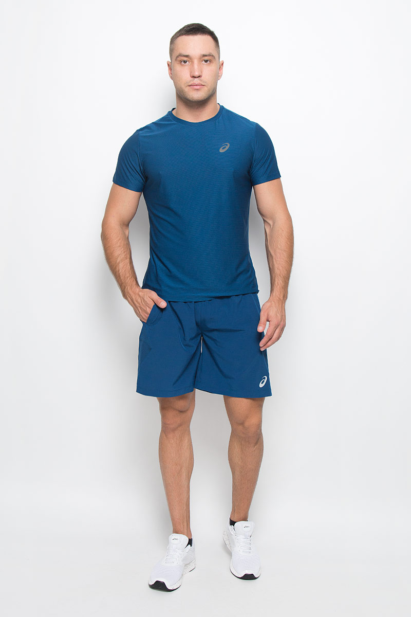Шорты для фитнеса мужские Asics Woven 7in, цвет: синий. 125136-8130. Размер L (50/52)125136-8130Мужские шорты Asics Woven 7in станут отличным дополнением к вашему спортивному гардеробу. Они выполнены из полиэстера с применением технологии Motion Dry, удобно сидят и превосходно отводят влагу от тела, оставляя кожу сухой. Модель дополнена широкой эластичной резинкой на поясе, двумя боковыми карманами и небольшим внутренним кармашком. Объем талии регулируется при помощи шнурка-кулиски на поясе. Шорты украшены логотипом Asics.Мягкие легкие шорты помогут улучшить спортивные результаты. Идеальны для тренировок, пробежек и прогулок.