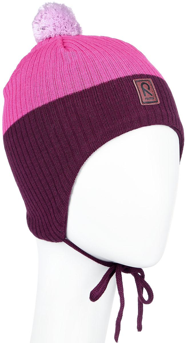 Шапка детская Reima Majava, цвет: розовый, бордовый. 518355-4620. Размер 50518355_4620Детская шапка Reima Majava прекрасно подойдет для прогулок в прохладную погоду. Шапка выполнена из шерсти и акрила, она мягкая и приятная на ощупь, идеально прилегает к голове.Шапка дополнена помпоном на макушке и завязками, которые фиксируются под подбородком. Супер мягкая подкладка из 100% хлопка и ветронепроницаемые вставки в области ушей обеспечат комфорт во время веселых зимних прогулок. Спереди модель дополнена нашивкой с логотипом бренда.Такая шапка станет отличным дополнением к детскому гардеробу, в ней ребенку будет тепло, уютно и комфортно. Уважаемые клиенты!Размер, доступный для заказа, является обхватом головы.