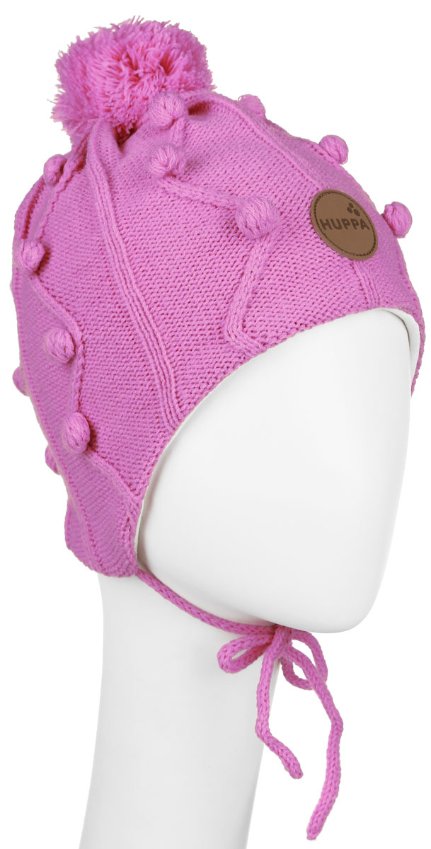 Шапка для девочки Huppa Ulla, цвет: розовый. 83880000-60013. Размер 55/5783880000-60013Вязанная шапка для девочки Huppa Ulla станет отличным дополнением к детскому гардеробу. Верх изделия изготовлен из натуральной акрила, а подкладка из качественного хлопка, что обеспечивает тепло и комфорт. Благодаря эластичной вязке, шапка идеально прилегает к голове ребенка.Шапка оформлена вязанным узором, на макушке модель имеет мягкий помпон. Изделие завязывается на шнурочки, тем самым обеспечивает тепло в холодную погоду и защищает детские ушки от холода. Дополнена шапочка нашивкой с названием бренда. Оригинальный дизайн и расцветка делают эту шапку стильным предметом детского гардероба. В ней ребенку будет тепло, уютно и комфортно. Уважаемые клиенты!Размер, доступный для заказа, является обхватом головы.