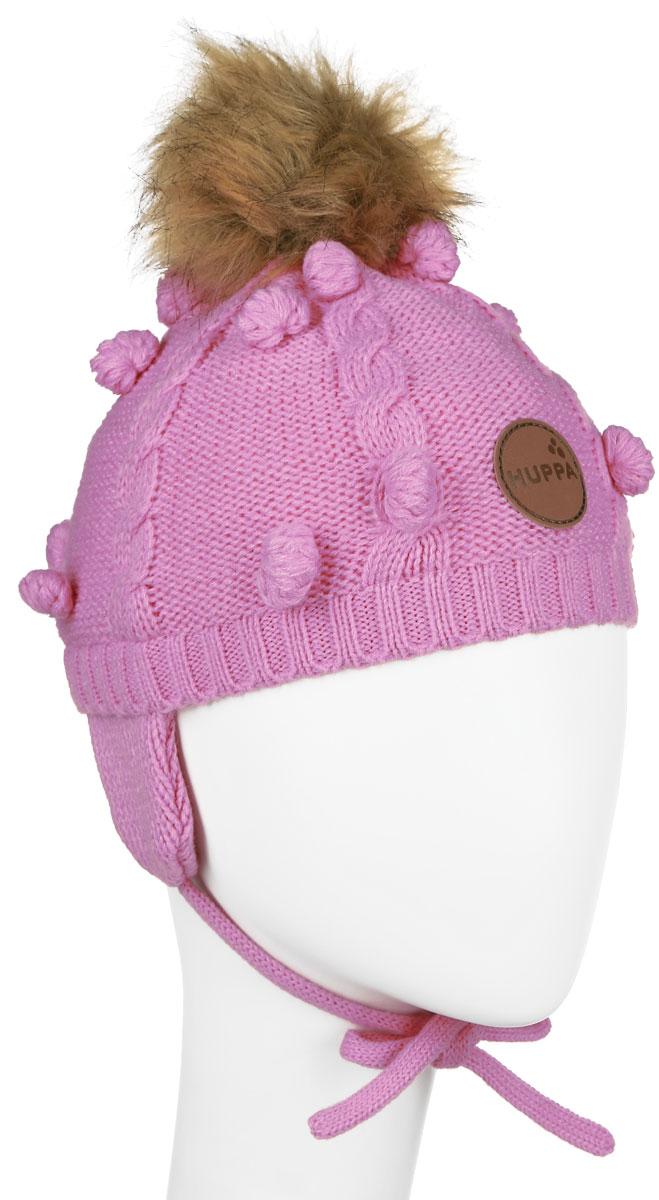 Шапка для девочки Huppa Macy, цвет: розовый. 83570000-60013. Размер 47/4983570000-60013Вязанная детская шапочка Huppa Macy станет отличным дополнением к детскому гардеробу. Верх изделия изготовлен из 100% акрила, а подкладка из качественного хлопка, что обеспечивает тепло икомфорт. Благодаря эластичной вязке, шапка идеально прилегает к голове ребенка.Шапка оформлена вязанным узором, на макушке модель имеет мягкий меховой помпон. Изделие завязывается на шнурочки, пришитые сбоку к удлиненным ушкам, тем самым обеспечивает тепло в холодную погоду и защищает детские ушки от холода. Дополнена шапочка нашивкой с названием бренда. Оригинальный дизайн и расцветка делают эту шапку стильным предметом детского гардероба. В ней ребенку будет тепло, уютно и комфортно. Уважаемые клиенты!Размер, доступный для заказа, является обхватом головы.