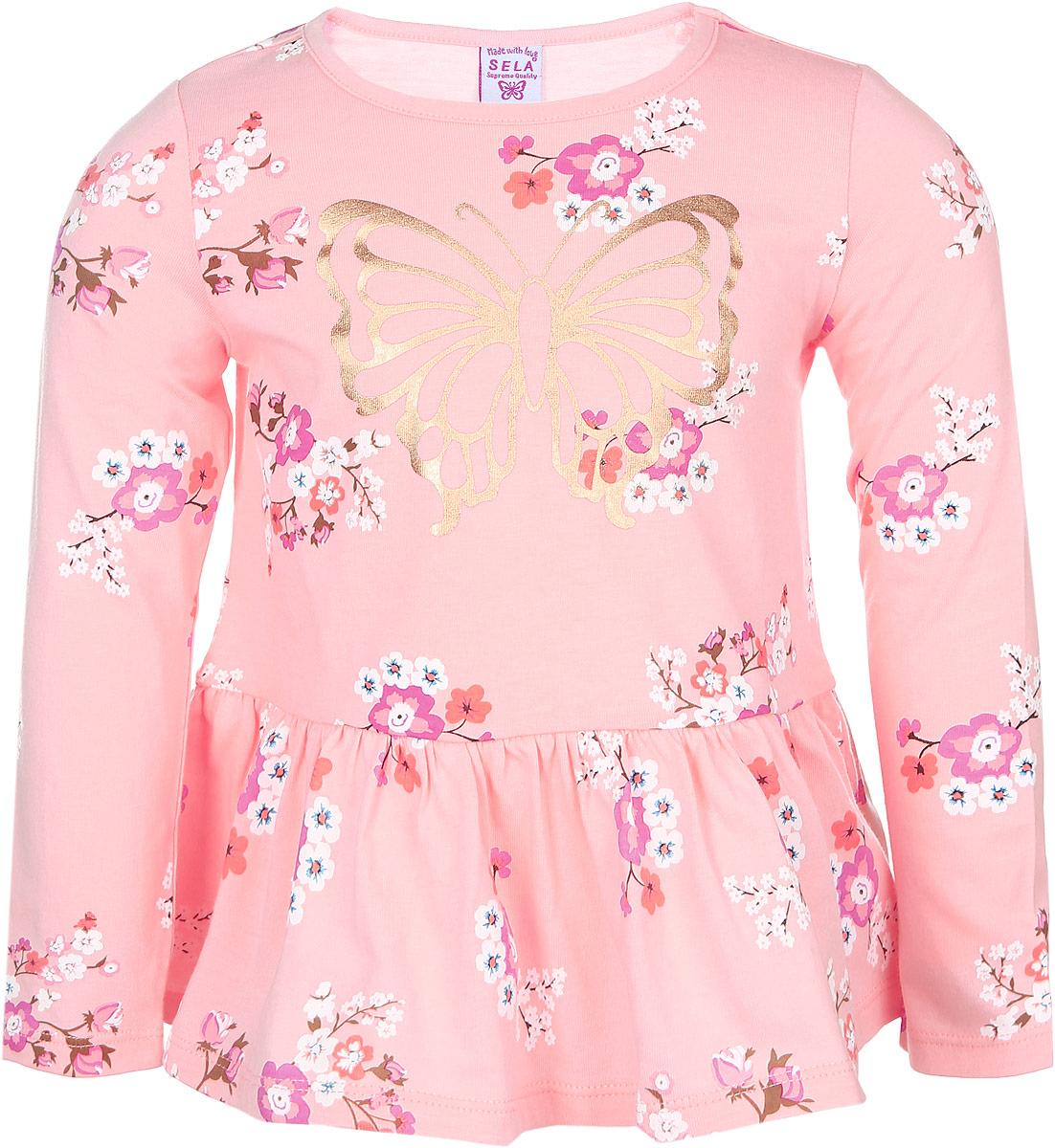 Туника для девочки Sela, цвет: персиковый. TKk-511/249-6424. Размер 104, 4 годаTKk-511/249-6424Туника для девочки Sela идеально подойдет вашей дочурке. Изготовленная из натурального хлопка, она необычайно мягкая и приятная на ощупь, не сковывает движения и позволяет коже дышать, не раздражает даже самую нежную и чувствительную кожу ребенка, обеспечивая ему наибольший комфорт. Туника с длинными рукавами и круглым воротником, оформлена цветочным принтом и бабочкой. Низ изделия дополнен оборкой со складочками, придающими изделию оригинальность. Воротник дополнен трикотажной эластичной резинкой. Оригинальный дизайн и модная расцветка делают эту тунику незаменимым предметом детского гардероба. В ней вашей маленькой принцессе будет комфортно, уютно и она всегда будет в центре внимания!