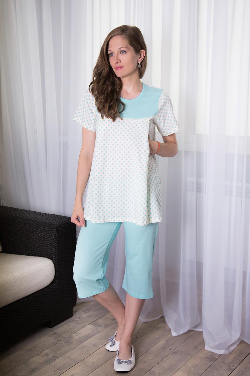 Комплект для беременных и кормящих Violett: футболка, бриджи, цвет: молочный, ментоловый. 7117140704. Размер S (44)7117140704Комплект для беременных и кормящих Violett, изготовленный из натурального хлопка, включает футболку и бриджи. Универсальность этого комплекта заключается в том, что его можно носить как во время беременности, так и после рождения ребенка. Футболка трапециевидного силуэта с круглым вырезом горловины и короткими рукавами спереди имеет скрытые прорези, что обеспечивает легкий доступ к груди для комфортного кормления малыша, а также максимального удобства ночных кормлений. Модель оформлена принтом в горох, а на груди декорирована однотонной вставкой с эластичной оборкой понизу.Однотонные бриджи длиной немного ниже колена дополнены на талии эластичной резинкой с затягивающимся шнурком.