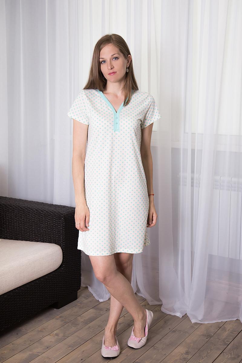 Платье домашнее Violett, цвет: молочный, ментоловый. 7117110721. Размер S (44)7117110721Домашнее платье Violett выполнено из натурального хлопка. Платье-миди свободного кроя с V-образным вырезом горловины и короткими рукавами оформлено принтом в горох, спереди - декоративными пуговицами.