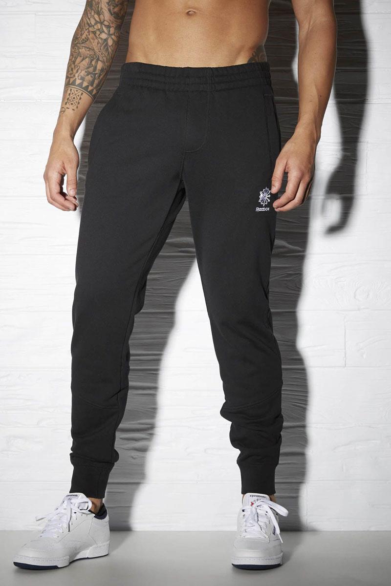 Брюки спортивные мужские Reebok F French Terry Pant, цвет: черный. AY1160. Размер XL (56/58)AY1160Мужские спортивные брюки F French Terry Pant от Reebok подарят вам особенный комфорт во время занятия спортом.Модель изготовлена из натурального хлопка. Стильные брюки не сковывают движений. Широкий эластичный пояс, дополненный шнурком, отвечает за идеальную посадку. Брючины дополнены эластичными манжетами. Спереди находятся два прорезных кармана, сзади - прорезной карман на застежке-молнии.