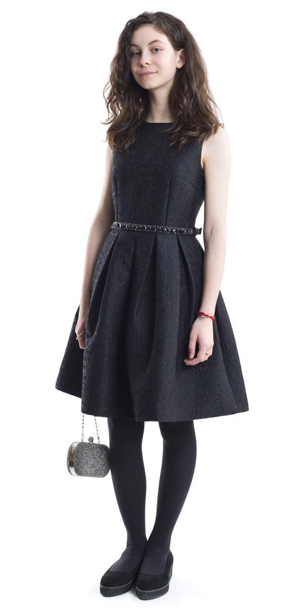 Платье для девочки Gulliver, цвет: черный. 216GPGTC2502. Размер 152216GPGTC2502Какими должны быть нарядные платья? Разными! Кто-то предпочитает купить платье - пышную модель как у настоящей принцессы, но кто-то выбирает стильные лаконичные решения с изюминкой и загадкой. Черное платье из благородного жаккардового полотна - идеальный вариант для тех, кто ценит изящество и элегантность. Пояс, расшитый стразами подчеркнет торжественность момента.