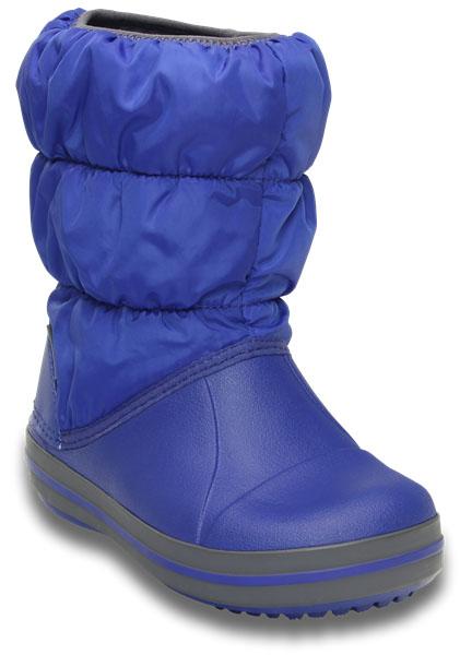 Дутики детские Crocs Winter Puff Boot, цвет: синий. 14613-4BH. Размер 11 (28)14613-4BHДетские дутики Winter Puff Boot от Crocs сохранят тепло в холодную погоду. Дутики выполнены из прочного водонепроницаемого и грязеотталкивающего текстиля и полимера Croslite. Литая непромокаемая носочная часть из материала Croslite гарантирует легкость и комфорт. Подкладка и стелька выполнены из мягкого текстиля, что обеспечит комфорт и уют ногам. Такая подкладка дышит, согревает и соответствует гигиеническим нормам. Подошва с протектором гарантирует идеальное сцепление на любой поверхности.Декоративный рант по периметру основания подошвы придает дутикам спортивный стиль.Рекомендуемый температурный режим: до -15-20С°.