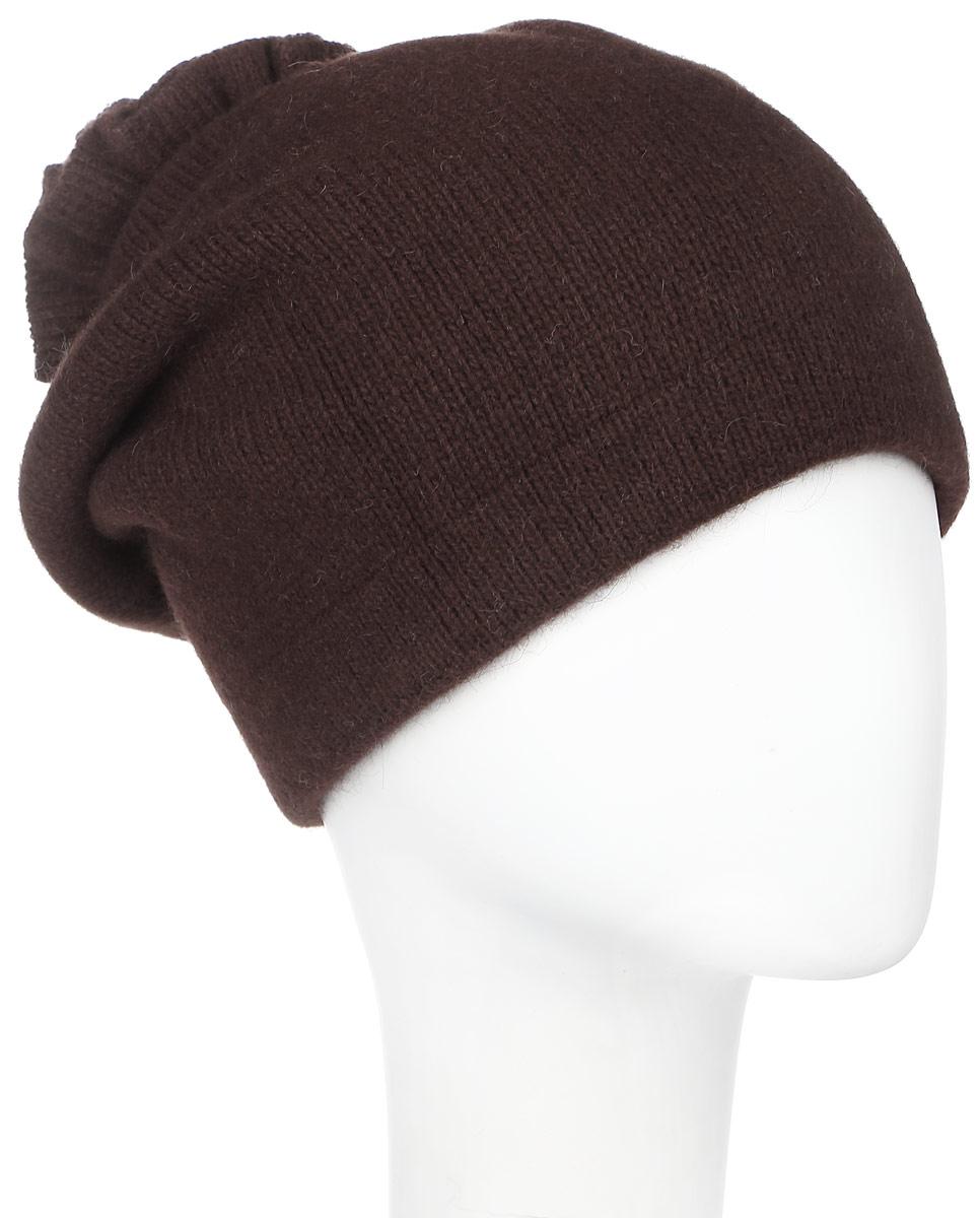 Шапка женская Vittorio Richi, цвет: коричневый. 261871L. Размер 56/58261871L-85Теплая женская шапка Vittorio Richi отлично дополнит ваш образ в холодную погоду. Сочетание шерсти, ангоры и полиамида сохраняет тепло и обеспечивает удобную посадку, невероятную легкость и мягкость.Удлиненная шапка выполнена плотной вязкой и дополнена на макушке оригинальным вязанным цветком. Модель составит идеальный комплект с модной верхней одеждой, в ней вам будет уютно и тепло.Уважаемые клиенты!Размер, доступный для заказа, является обхватом головы.