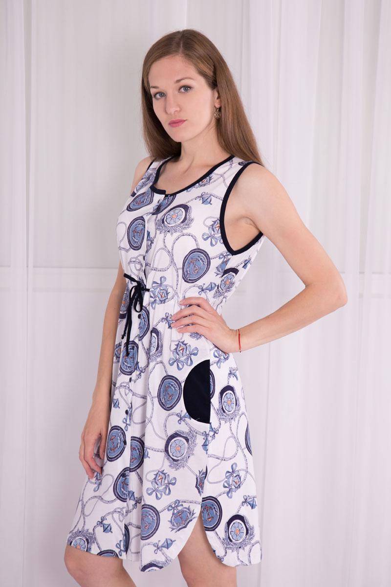 Платье-халат Violett, цвет: белый, синий. 7117110102. Размер XL (50)7117110102Платье-халат Violett выполнен из натурального хлопка. Платье с круглым вырезом горловины застегивается на пуговицы по всей длине. Спереди расположены два кармана. Модель оформлена принтом в морском стиле. Под грудью изделие оснащено затягивающимся шнурком.