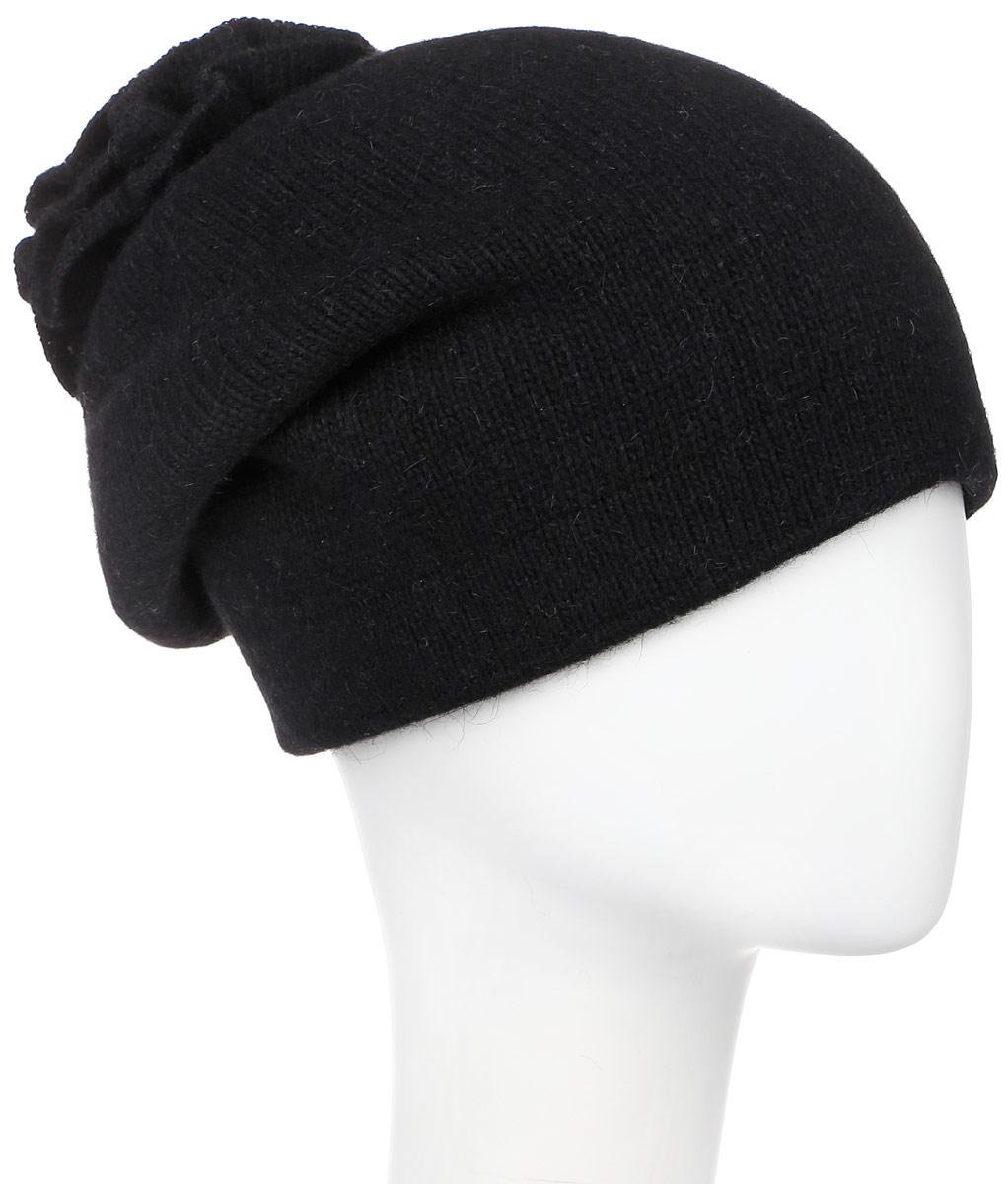 Шапка женская Vittorio Richi, цвет: черный. 261871L. Размер 56/58261871L-18Теплая женская шапка Vittorio Richi отлично дополнит ваш образ в холодную погоду. Сочетание шерсти, ангоры и полиамида сохраняет тепло и обеспечивает удобную посадку, невероятную легкость и мягкость.Удлиненная шапка выполнена плотной вязкой и дополнена на макушке оригинальным вязанным цветком. Модель составит идеальный комплект с модной верхней одеждой, в ней вам будет уютно и тепло.Уважаемые клиенты!Размер, доступный для заказа, является обхватом головы.