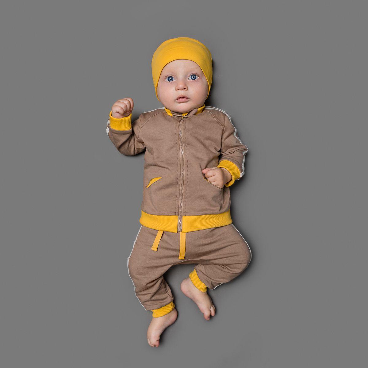 Комплект для мальчика Ёмаё: кофточка, штанишки, цвет: коричневый, оранжевый. 29-507. Размер 6829-507Очаровательный комплект для мальчика Ёмаё, состоящий из кофточки и штанишек спортивного стиля, идеально подойдет вашему малышу. Изготовленный из футера, он необычайно мягкий и приятный на ощупь, не сковывает движения ребенка и позволяет коже дышать, не раздражает даже самую нежную и чувствительную кожу малыша, обеспечивая наибольший комфорт. Кофточка с длинными рукавами и небольшим воротником-стойкой застегивается на пластиковую застежку-молнию с защитой подбородка, что позволяет с легкостью переодеть младенца. Рукава дополнены широкими трикотажными манжетами. Спереди предусмотрены два прорезных кармашка. Штанишки имеют широкий эластичный пояс со шнурком, не сдавливающий животик ребенка. Сзади предусмотрен накладной кармашек. Низ штанин дополнен эластичными манжетами. Оформлен комплект контрастными бейками. В таком комплекте ваш малыш будет чувствовать себя уютно и комфортно, и всегда будет в центре внимания.