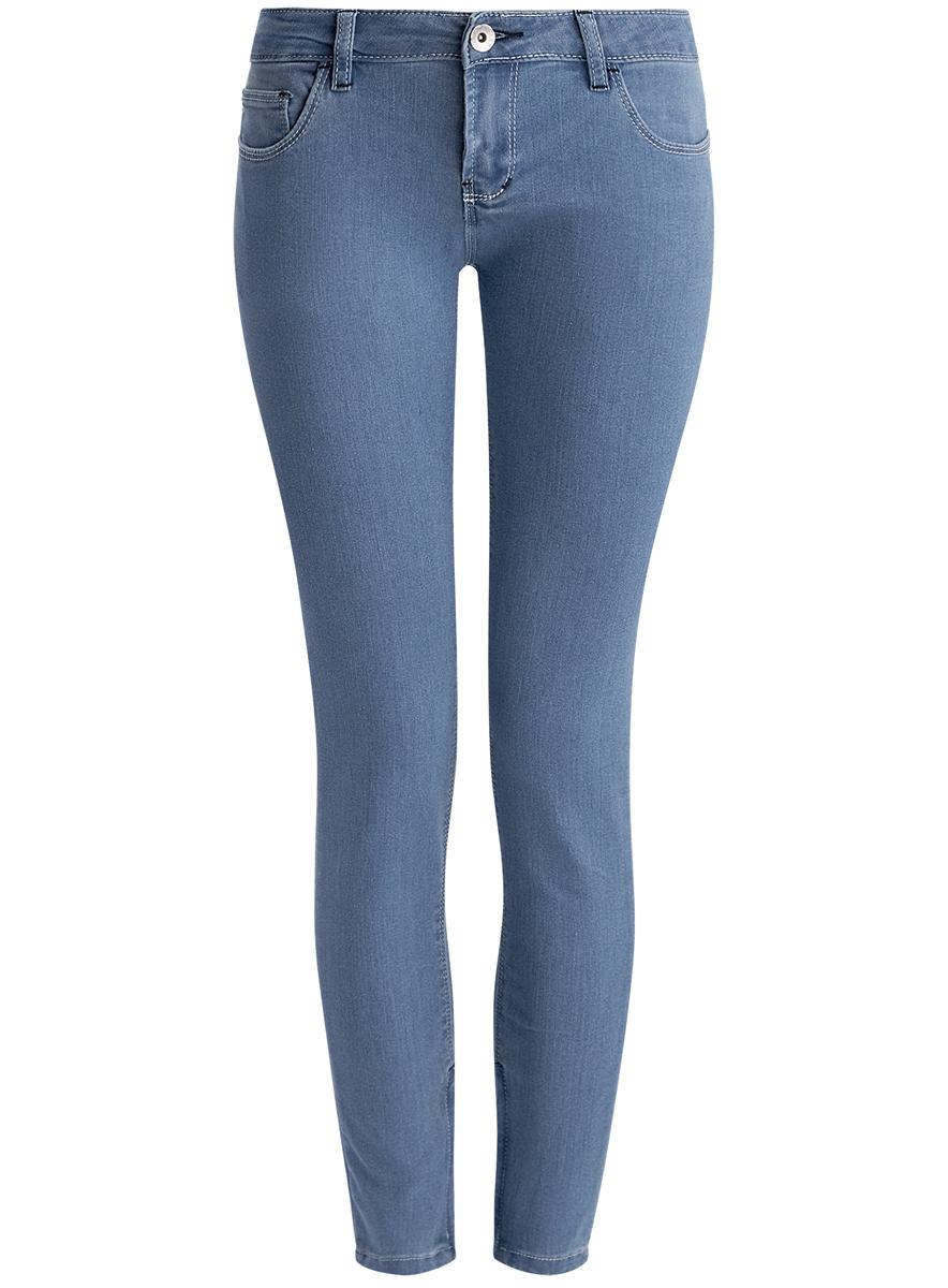 Джинсы женские oodji Ultra, цвет: голубой. 12106042/42601/7500W. Размер 26-32 (42-32)12106042/42601/7500WЖенские джинсы oodji Ultra выполнены из высококачественного эластичного хлопка с добавлением полиэстера. Джинсы-скинни заниженной посадки застегиваются на пуговицу в поясе и ширинку на застежке-молнии, дополнены шлевками для ремня. Джинсы имеют классический пятикарманный крой: спереди модель дополнена двумя втачными карманами и одним маленьким накладным кармашком, а сзади - двумя накладными карманами. Джинсы дополнена застежками-молниями по низу брючин.