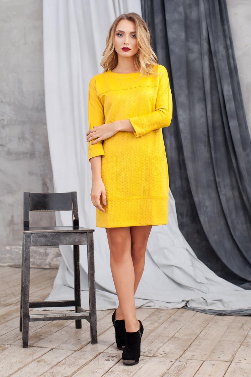 Платье Ruxara, цвет: горчичный. 0105404. Размер 500105404Стильное платье из плотного структурного трикотажа. Модель полуприлегающего силуэта с цельнокроеным рукавом. Впереди выполнены накладные карманы. Сзади застежка на пуговицу. Прекрасный вариант на каждый день.