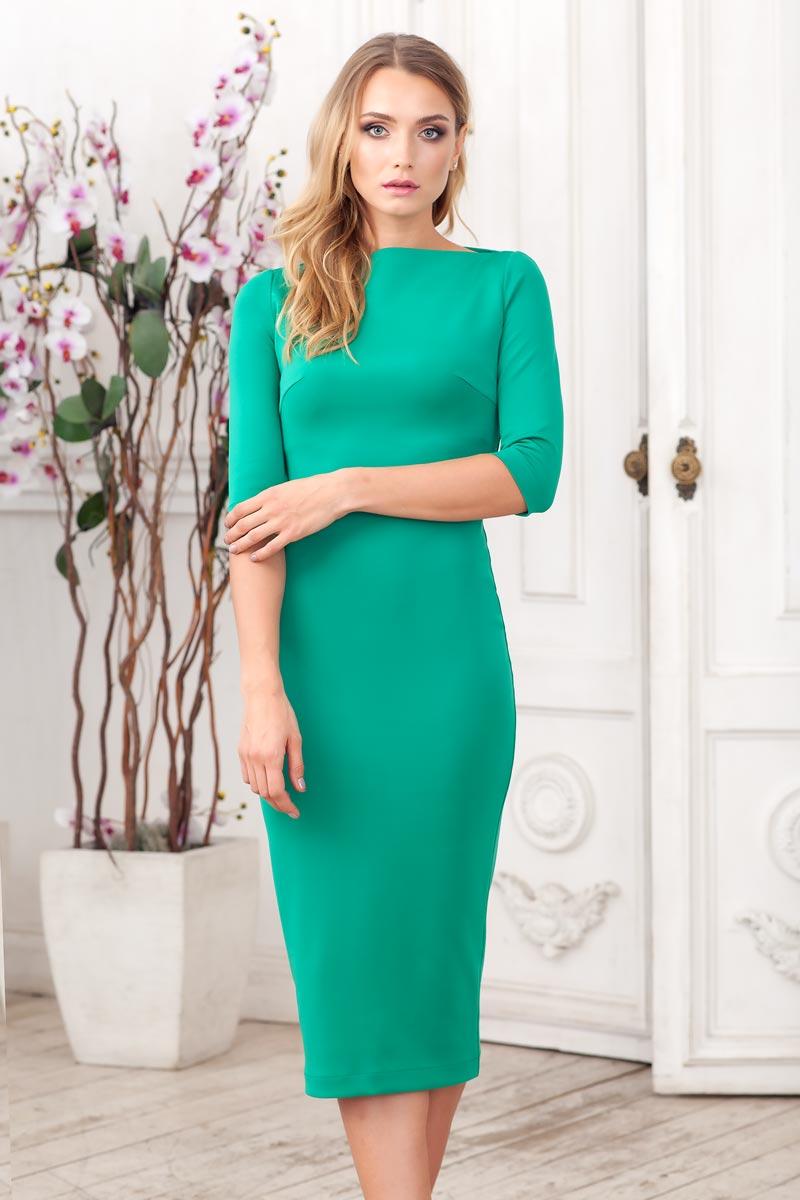 Платье Ruxara, цвет: темно-зеленый. 0105305. Размер 420105305Элегантное платье-футляр из плотного однотонного трикотажа. Модель прилегающего силуэта длиной ниже колена с рукавом 3/4. Сзади выполнен разрез с молнией. Отлично подойдёт, как на каждый день, так и на выход.