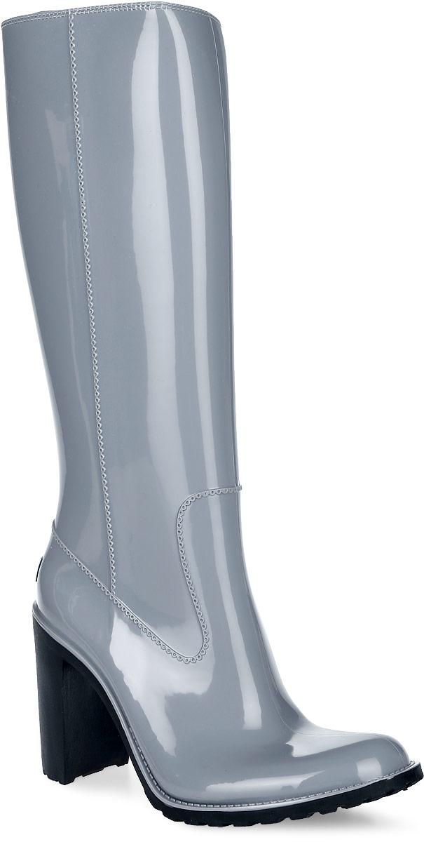 Резиновые сапоги женские Boomboots, цвет: серый. G36/Gray. Размер 41G36/GrayРезиновые сапоги на каблуке от Boomboots выполнены из поливинилхлорида. Цельнолитая модель полностью герметична и оформлена ажурными элементами, имитирующими швы. Изделие на застежке-молнии. Стелька изготовлена из вспененного полимера с текстильным покрытием. Задник дополнен логотипом бренда. Подошва оснащена рифлением.