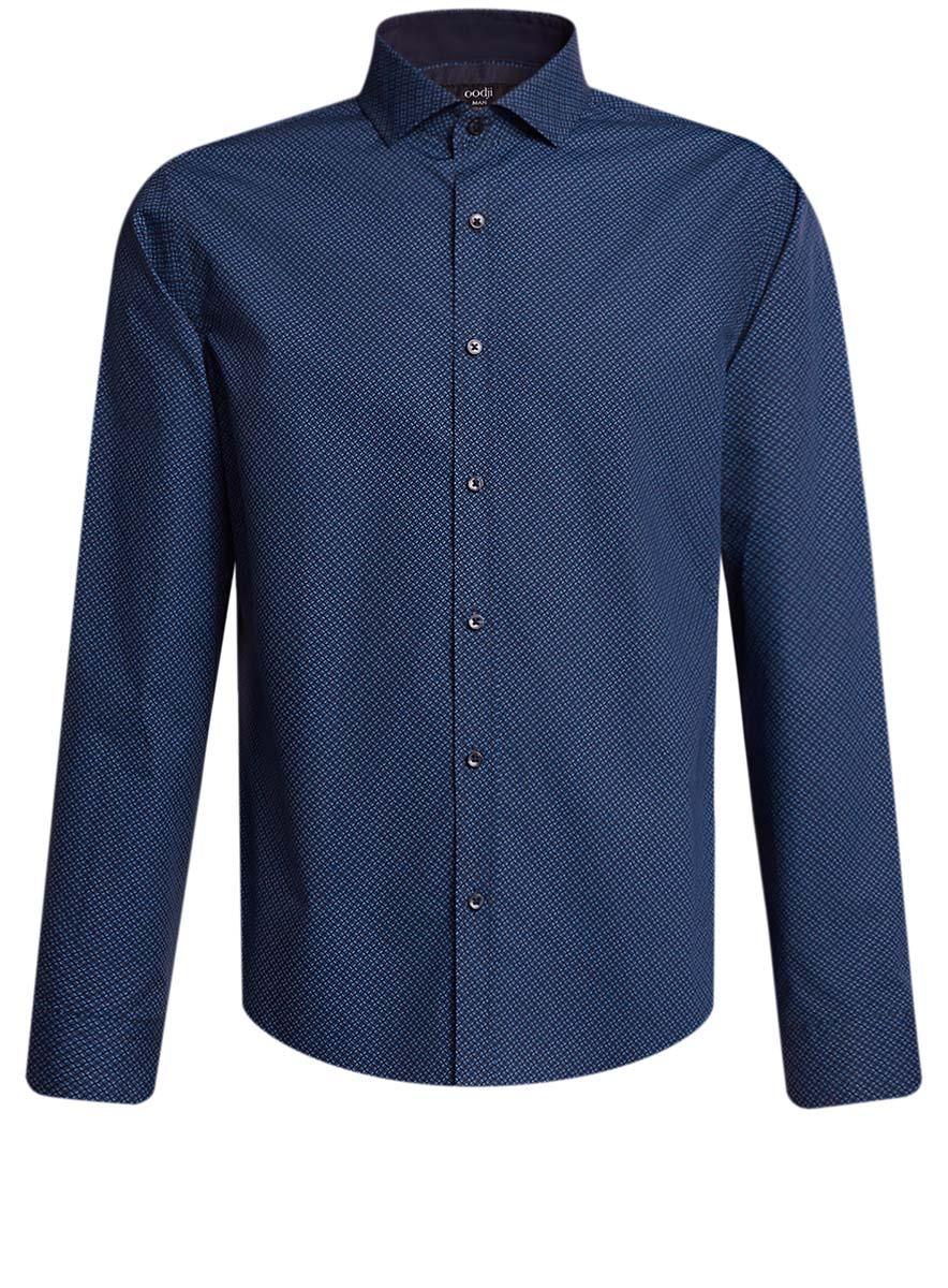 Рубашка мужская oodji, цвет: темно-синий, синий. 3L110239M/19370N/7975G. Размер 38 (44-182)3L110239M/19370N/7975GСтильная мужская рубашка oodji выполнена из натурального хлопка. Модель с отложным воротником и длинными рукавами застегивается на пуговицы спереди. Манжеты рукавов дополнены застежками-пуговицами. Оформлена рубашка оригинальным узорчатым принтом.