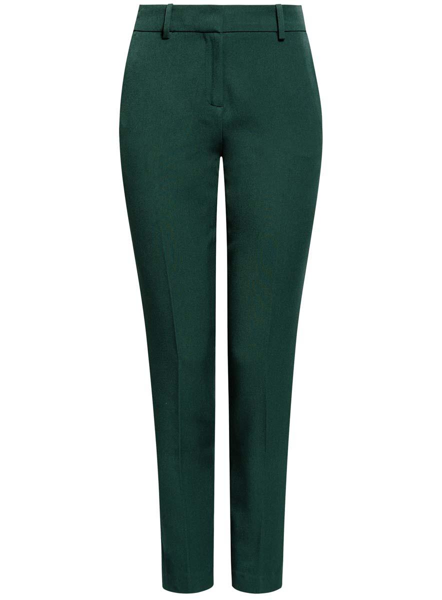 Брюки женские oodji Ultra, цвет: темно-зеленый. 11706202-2/22434/6900N. Размер 44 (50-170)11706202-2/22434/6900NСтильные женские брюки oodji Ultra изготовлены из качественного комбинированного материала. Модель-слим со стандартной посадкой выполнена в лаконичном стиле. Застегиваются брюки на застежку-молнию, потайную пуговицу и металлический крючок, а также дополнены в поясе шлевками для ремня. Спереди изделие оформлено двумя втачными карманами, а сзади двумя карманами-обманками.