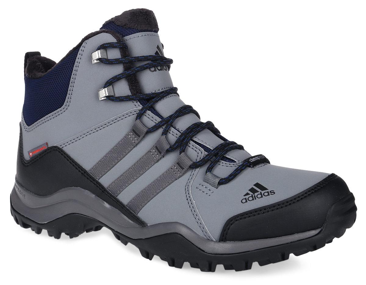 Ботинки мужские adidas CW Winterhiker II C, цвет: серый, черный. AQ4111. Размер 12 (46)AQ4111Мужские туристические ботинки CW Winterhiker II C от adidas предназначены для пеших походов в суровых зимних условиях. Прочный верх из искусственной кожи с текстильным голенищем, мягкая подкладка из искусственного меха и литая стелька обеспечивают комфорт и удобную посадку. Водонепроницаемая мембрана Climaproof защищает ноги от влаги, технология Climawarm сохраняет ноги в тепле и сухости. Подошва из резины Continental обеспечивает непревзойденное сцепление даже с влажной поверхностью. Высокотехнологичный синтетический наполнитель Primaloft продолжает греть даже во влажном состоянии, вставка Adiprene в пяточной части превосходно амортизирует при ударных нагрузках. Классическая шнуровка надежно зафиксирует модель на ноге. По бокам модель оформлена фирменными тремя полосками.