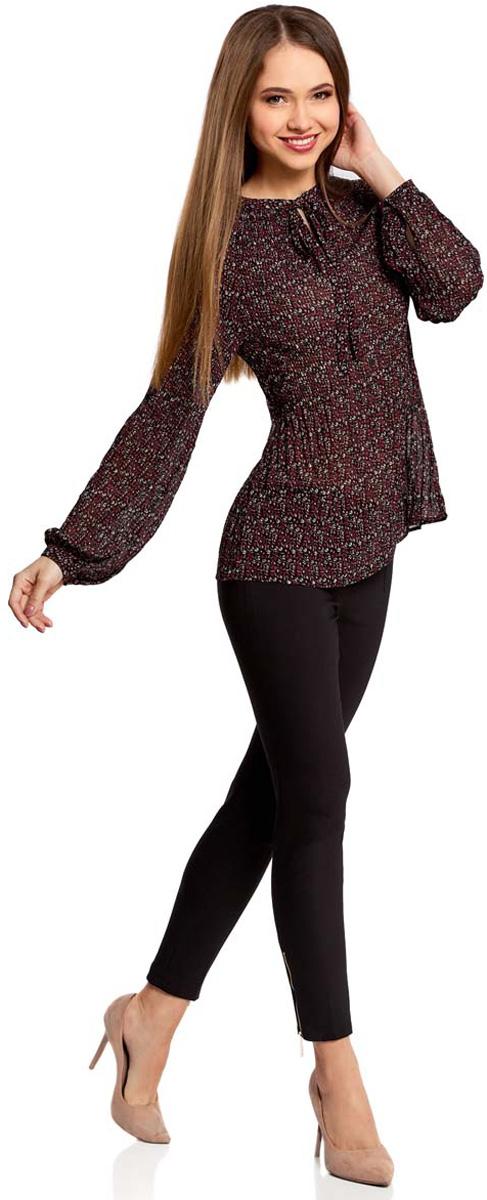 Блузка женская oodji Ultra, цвет: бордовый, розовый. 11414005/46166/494AF. Размер 40 (46-170)11414005/46166/494AFЖенская блузка oodji Ultra полностью выполнена из полиэстера. Модель из гофрированной ткани с воротником-аскот, узким вырезом на груди и длинными рукавами-реглан. Рукава дополнены манжетами с пуговицами.