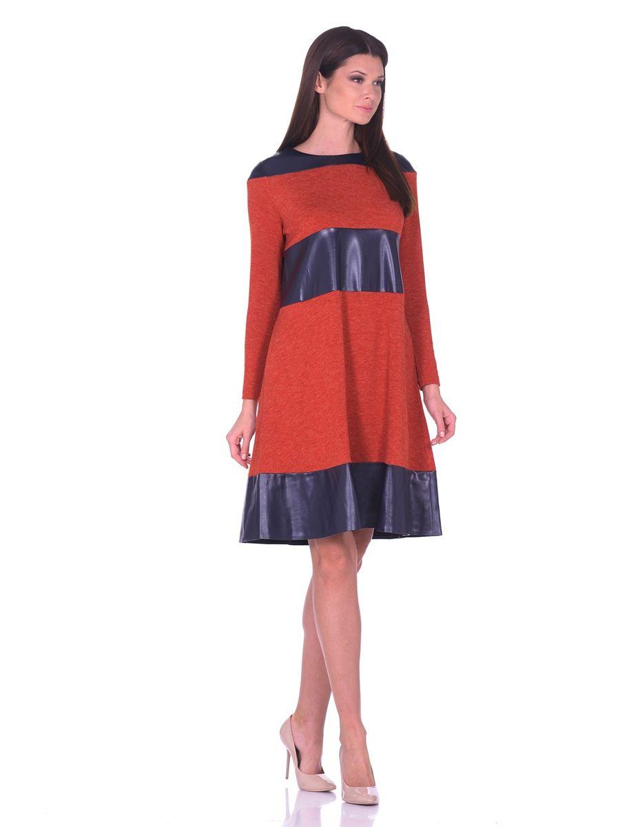 Платье La Via Estelar, цвет: терракотовый, темно-синий. 14670-1. Размер 4614670-1Платье La Via Estelar выполнено из полиэстера, вискозы и эластана. Модель-миди с круглым вырезом горловины и длинным рукавом оформлена вставками из искусственной кожи. По бокам расположены втачные карманы.