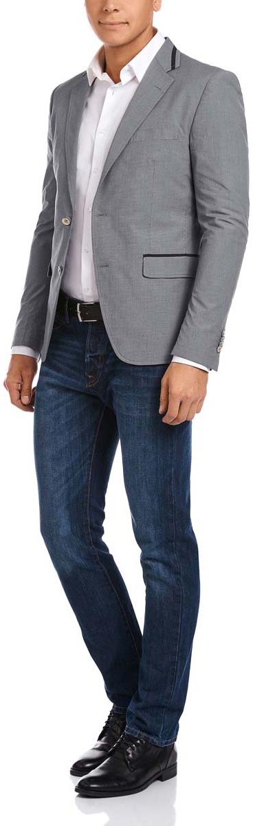 Пиджак мужской oodji, цвет: серый, темно-синий. 2L440155M/44228N/2379O. Размер 52-182 (52-182)2L440155M/44228N/2379OМужской пиджак oodji скроен по классическому силуэту и плотно садится по фигуре. Имеет длинные рукава, воротник с лацканами, карман слева на груди и два кармана по бокам от талии. Застегивается на пуговицы спереди и на манжетах. Сзади имеется шлица. Оформлен контрастной окантовкой.