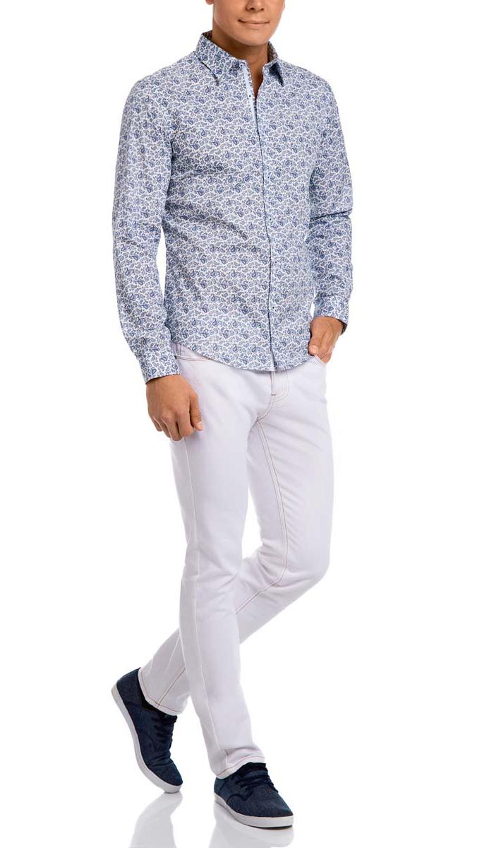 Рубашка мужская oodji, цвет: белый, темно-синий. 3L110187M/34156N/1029E. Размер 42-182 (52-182)3L110187M/34156N/1029EМужская рубашка oodji выполнена из натурального хлопка. Рубашка с длинными рукавами и отложным воротником застегивается на пуговицы спереди. Манжеты рукавов также застегиваются на пуговицы. Оформлена модель оригинальным принтом.