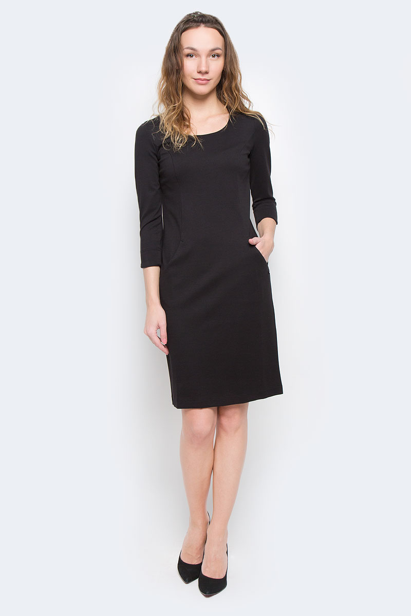 Платье Finn Flare, цвет: черный. W15-11025. Размер XS (42)W15-11025Элегантное платье Finn Flare выполнено из полупрозрачного струящегося материала и имеет плотную непрозрачную подкладку. Такое платье обеспечит вам комфорт и удобство при носке.Модель с рукавами 3/4 и круглым вырезом горловины выгодно подчеркнет все достоинства вашей фигуры. Сзади платье украшено имитацией застежки на кнопках. Платье дополнено двумя открытыми втачными карманами. Изысканное однотонное платье-миди создаст обворожительный и неповторимый образ.Это модное и удобное платье станет превосходным дополнением к вашему гардеробу, оно подарит вам удобство и поможет вам подчеркнуть свой вкус и неповторимый стиль.