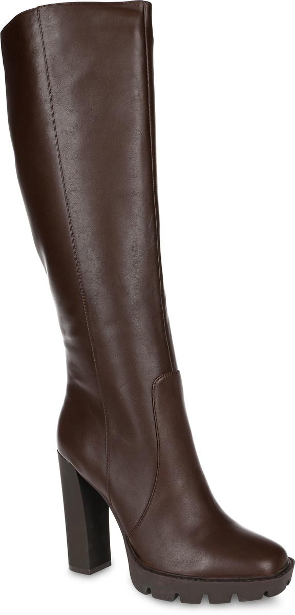 Сапоги женские Paolo Conte, цвет: темно-коричневый. 91-131-03-5. Размер 3891-131-03-5Стильные женские сапоги от Paolo Conte выполнены из натуральной кожи. Подкладка и стелька выполнены из байки. Застегивается модель на боковую застежку-молнию. Эластичные вставки на голенище обеспечивают идеальную посадку модели на ноге. Ультравысокий каблук компенсирован небольшой платформой. Подошва и каблук дополнены рифлением.