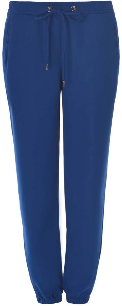 Брюки женские oodji Ultra, цвет: синий. 11709033/42720/7500N. Размер 38-170 (44-170)11709033/42720/7500NЖенские брюки oodji Ultra стандартной посадки изготовлены из полиэстера с добавлением эластана. Брюки на поясе дополнены широкой эластичной резинкой и затягивающимся шнурком. Спереди модель оформлена имитацией прорезных карманов. Брюки понизу дополнены широкими эластичными резинками.