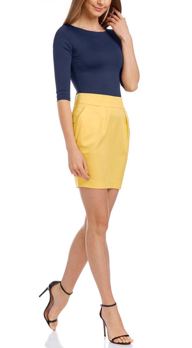 Юбка oodji Ultra, цвет: лимонный. 11605061-1/35319/5100N. Размер 36 (42-170)11605061-1/35319/5100NЮбка oodji Ultra выполнена из лиоцелла с добавлением хлопка. Укороченная юбка-карандаш застегивается на застежку-молнию на спинке. Спереди юбка оформлена декоративными тонкими складками, а также дополнена двумя втачными карманами.