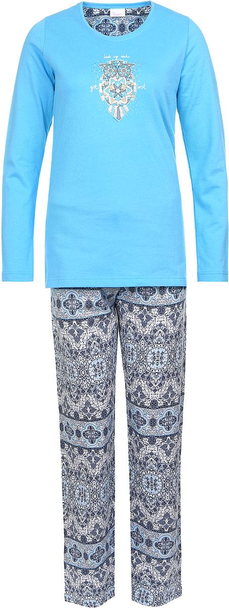 Костюм домашний женский Vienettas Secret Сова: толстовка, брюки, цвет: голубой, темно-серый. 606048 0312. Размер M (46)606048 0312Женский домашний костюм Vienettas Secret состоит из толстовки и брюк. Внутренняя сторона изделия выполнена на мягкой и приятной на ощупь байки.Толстовка с круглым вырезом горловины и длинными рукавами, изготовленная из эластичного хлопка, оформлена спереди стильным принтом с изображением совы.Брюки, выполненные из натурального хлопка, дополнены эластичным поясом на шнурке и оформлены принтом с узорами.