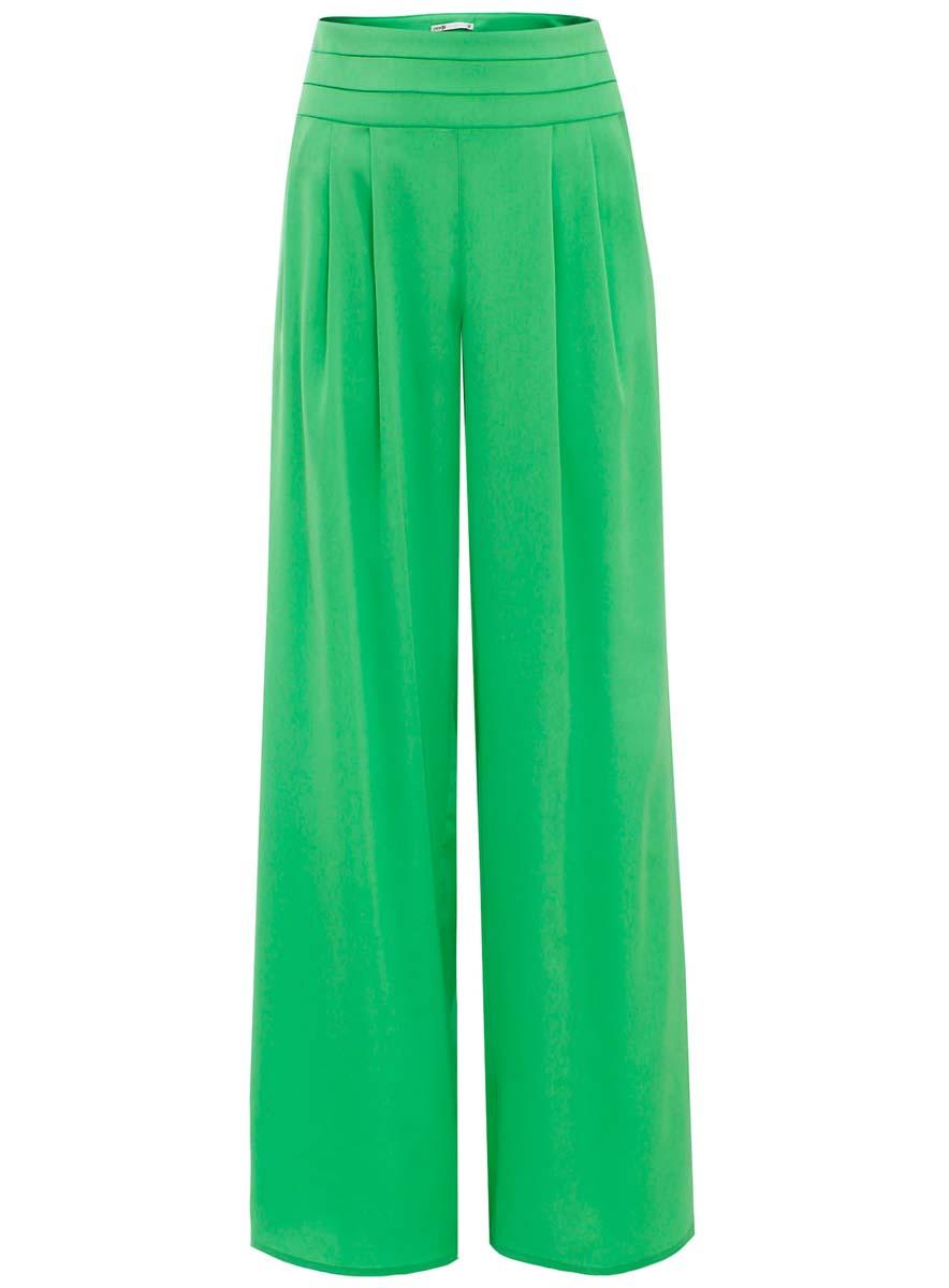 Брюки женские oodji Collection, цвет: светло-зеленый. 21705058-1/35185/6A00N. Размер 42-170 (48-170)21705058-1/35185/6A00NСтильные женские брюки oodji Collection выполнены из полиэстера с добавлением полиуретана. Модель стандартной посадки застегивается на скрытую застежку-молнию, расположенную сбоку. Брючины имеют широкий крой.