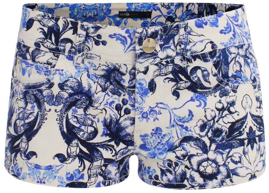 Шорты женские oodji Denim, цвет: белый, темно-синий. 12807035-1/26514/1079E. Размер 29 (48)12807035-1/26514/1079EСтильные женские шорты oodji Denim изготовлены из хлопка с добавлением эластана. Шорты застегиваются на металлическую пуговицу и ширинку на застежке-молнии. На поясе предусмотрены шлевки для ремня. Спереди расположены два прорезных кармана и один маленький накладной кармашек, сзади - два накладных кармана. Модель дополнена цветочным принтом.
