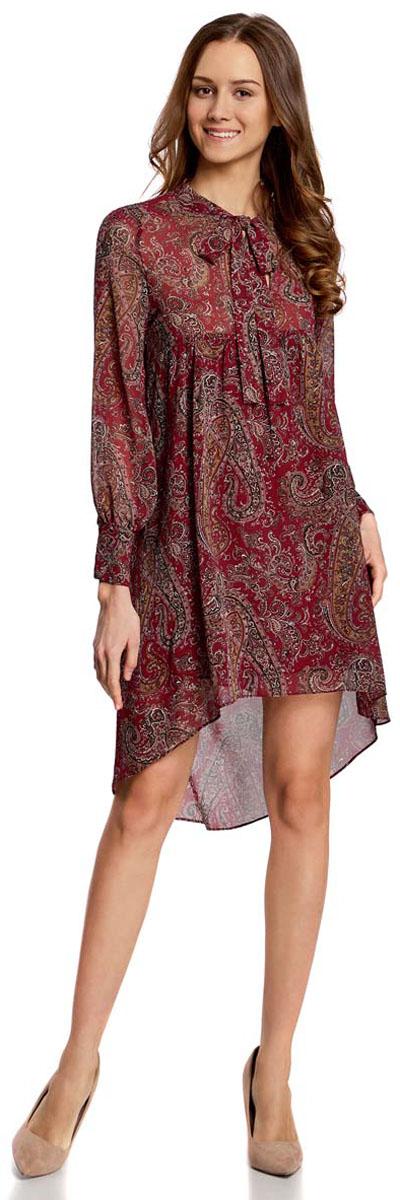 Платье oodji Ultra, цвет: бордовый, коричневый. 11913032/38375/4912E. Размер 38-170 (44-170)11913032/38375/4912EПлатье oodji Ultra исполнено из воздушной, легкой ткани. Имеет свободный крой и V-образный вырез воротника, оформленный завязками под горлом. Платье выполнено с длинными рукавами-баллонами, застегивающимися на манжетах на пуговицы и ассиметричной юбкой, удлиненной сзади шлейфом.