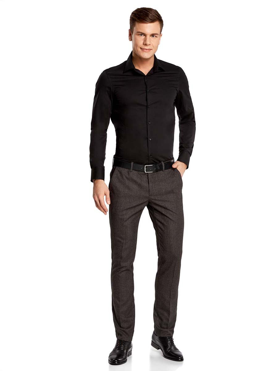 Рубашка мужская oodji Basic, цвет: черный. 3B140000M/34146N/2900N. Размер 40-182 (48-182)3B140000M/34146N/2900NБазовая мужская рубашка приталенного силуэта (extra slim) oodji Basic изготовлена из хлопка с добавлением полиамида и эластана. Она мягкая и приятная на ощупь, не сковывает движения и позволяет коже дышать, обеспечивая наибольший комфорт. Рубашка с отложным воротником и длинными рукавами застегивается на пуговицы. Манжеты рукавов также застегиваются на пуговицы.