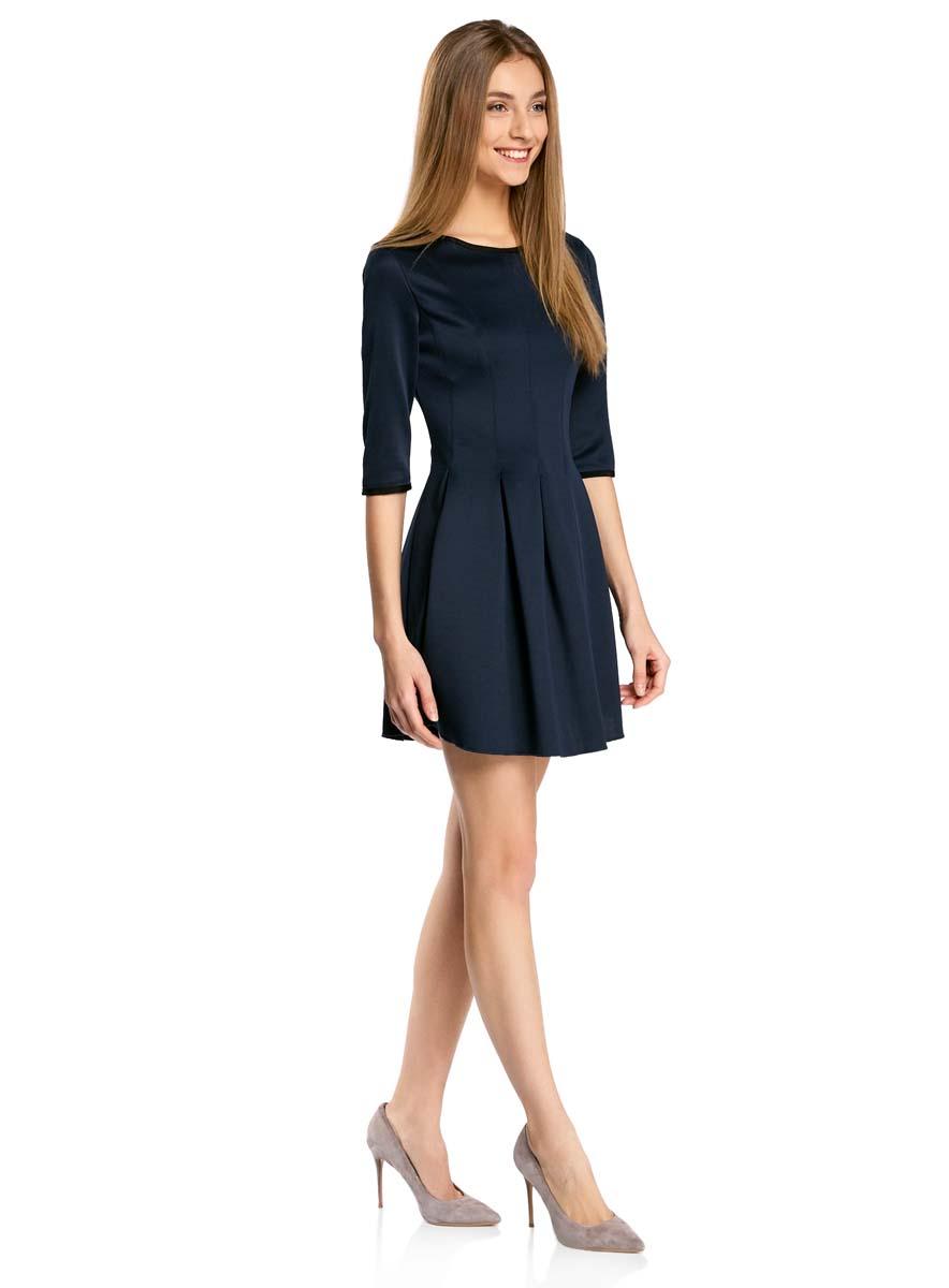Платье oodji Ultra, цвет: темно-синий. 14001148-1/33735/7900N. Размер L (48)14001148-1/33735/7900NПлатье oodji Ultra изготовлено из эластичной плотной облегающей ткани. Модель имеет юбку с клиньями, рукава 3/4, круглый вырез воротника и застегивается на крючок сзади.