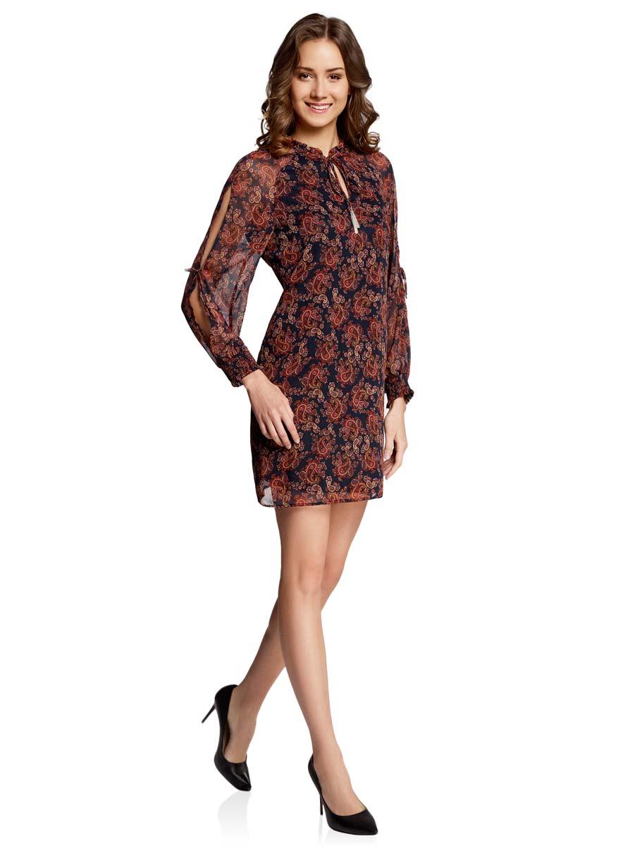 Платье oodji Ultra, цвет: темно-синий, бордовый. 11914001/15036/7949E. Размер 36-170 (42-170)11914001/15036/7949EСтильное платье oodji Ultra выполнено из качественного полиэстера. Подкладка изделия также изготовлена из полиэстера. Модное шифоновое платье-мини с круглым вырезом горловины и длинными рукавами-реглан дополнена спереди завязками. Завязки имеют на кончиках оригинальные металлические кисточки. Рукава модели дополнены манжетами на широких резинках и оригинальными прорезями вдоль рукава с завязками-бантиками. Вырез горловины оформлен нежной рюшей.
