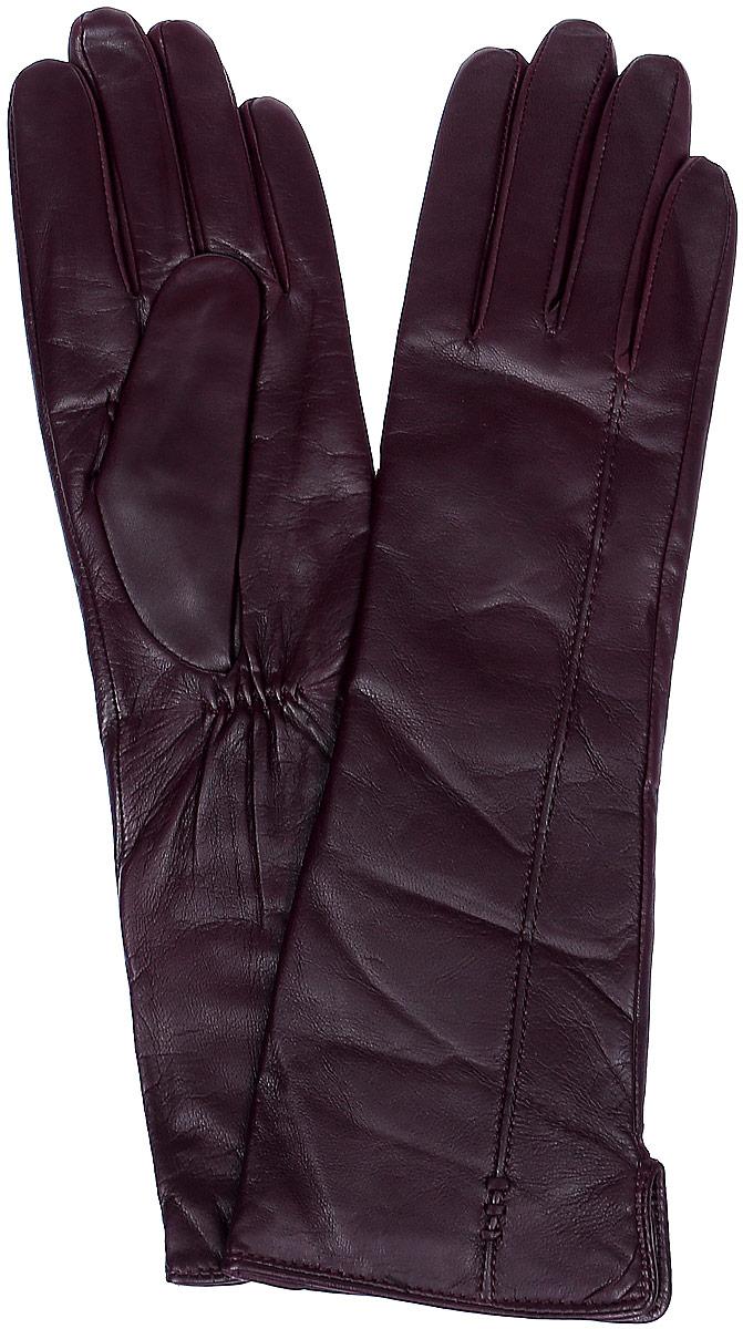 Перчатки женские Labbra, цвет: баклажановый. LB-0195. Размер 6,5LB-0195Стильные женские перчатки Labbra выполнены из натуральной кожи и дополнены эластичными резинками, которые надежно зафиксируют модель на запястье. Удлиненная модель оформлена декоративной прострочкой. Внутренняя поверхность выполнена из шерсти и акрила, которые обеспечат тепло и комфорт.
