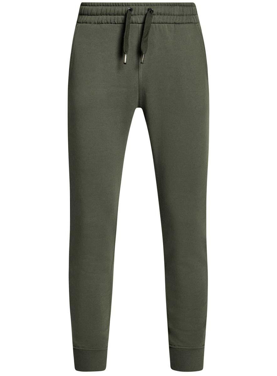 Брюки спортивные мужские oodji Basic, цвет: хаки. 5B200004M/44119N/6600N. Размер S (46/48)5B200004M/44119N/6600NУдобные мужские спортивные брюки oodji Basic, выполненные из хлопка, великолепно подойдут для отдыха, повседневной носки, а также для занятий спортом. Брюки зауженного к низу кроя и средней посадки имеют широкую эластичную резинку на поясе, объем талии регулируется при помощи шнурка-кулиски. Спереди изделие имеет два втачных кармана, а сзади один накладной. Низ брючин дополнен широкими манжетами.