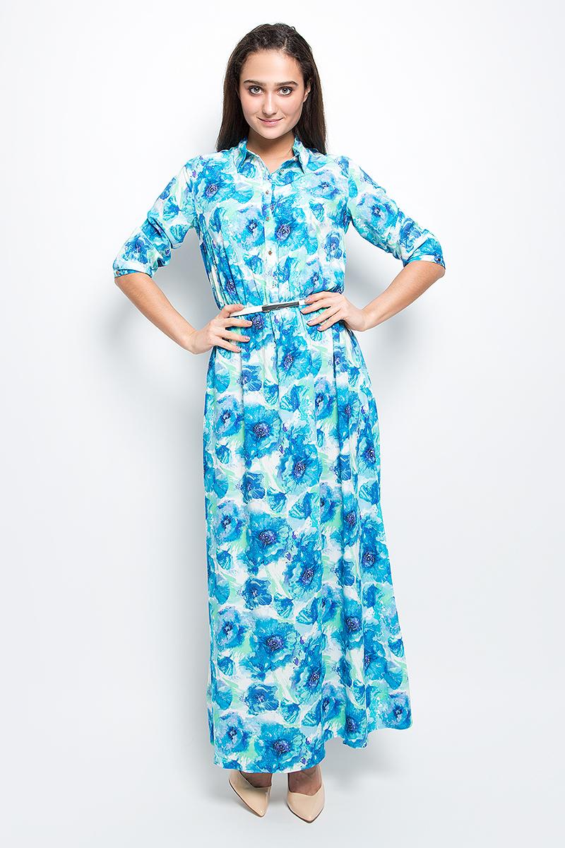 Платье Finn Flare, цвет: голубой. B17-11072_139. Размер L (48)B17-11072_139Красивое платье Finn Flare изготовлено из 100% вискозы. Модель с отложным воротником и рукавами 3/4 на талии дополнена эластичной резинкой. Изделие застегивается на пуговицы и дополнено поясом. Оформлена модель цветочным принтом.