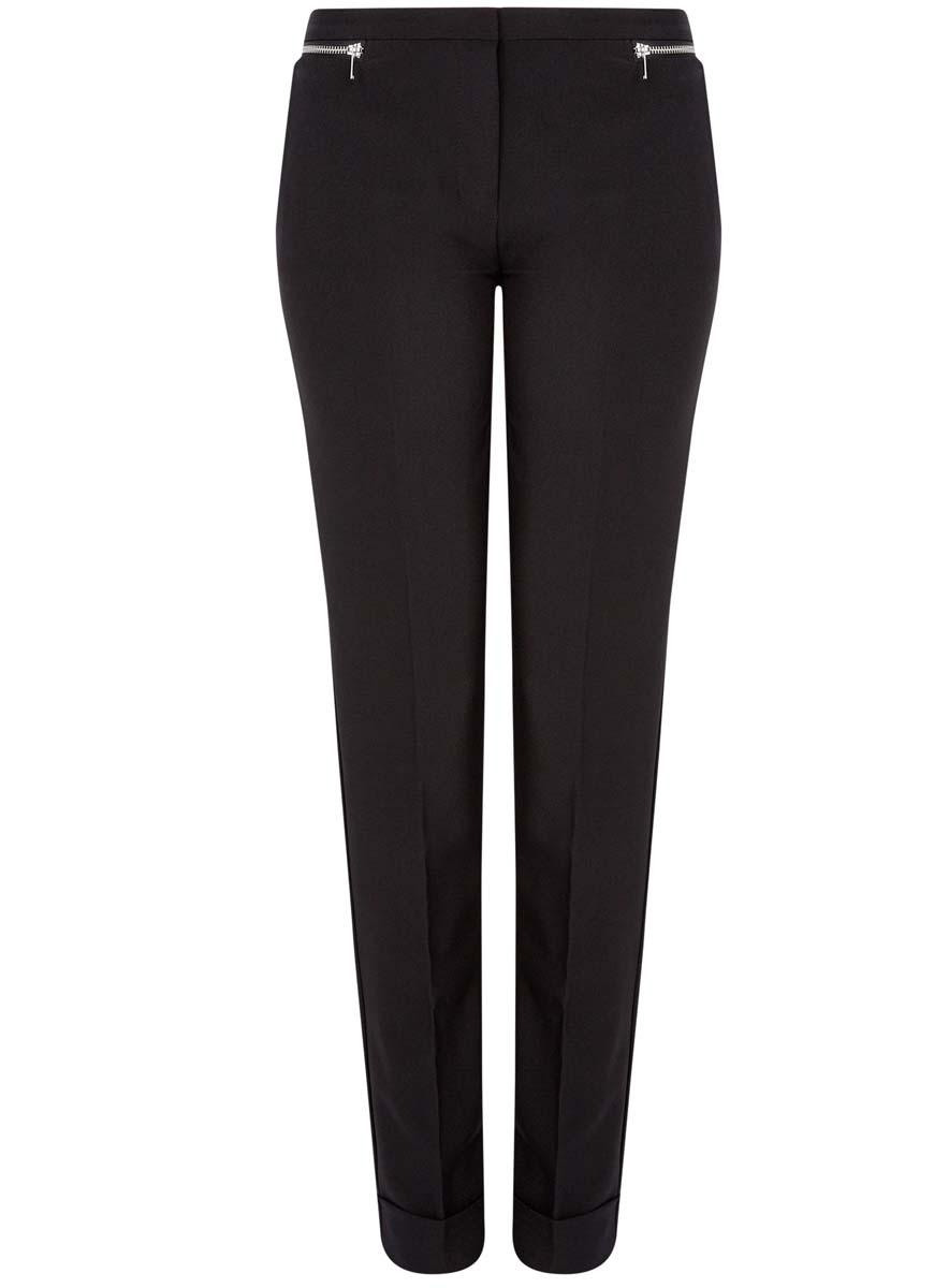 Брюки женские oodji Ultra, цвет: черный. 11701033-3/45660/2900N. Размер 36-170 (42-170)11701033-3/45660/2900NСтильные женские брюки oodji Ultra изготовлены из качественного комбинированного материала. Модель-слим со стандартной посадкой выполнена в лаконичном стиле и по низу брючин оформлена стильными манжетами. Застегиваются брюки на застежку-молнию, потайную пуговицу и металлический крючок в поясе. Спереди изделие оформлено двумя втачными карманами и декоративными молниями, а сзади двумя карманами-обманками.