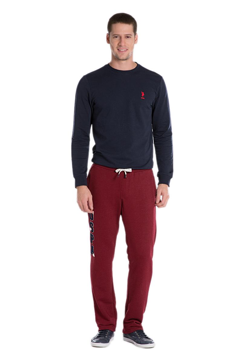 Брюки спортивные мужские U.S. Polo Assn., цвет: красный. G081SZ0OP0NARI_KR0215. Размер XL (54)G081SZ0OP0NARI_KR0215Спортивные брюки выполнены из высококачественного трикотажа. На талии модель дополнена затягивающимся шнурком, сзади имеется прорезной кармашек.