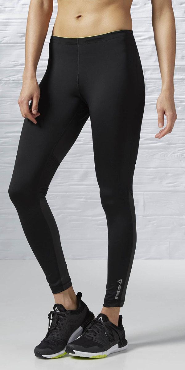 Тайтсы женские Reebok Re Tight, цвет: черный. AX9786. Размер M (46/48)AX9786Леггинсы Reebok Re Tight выполнены из гладкого трикотажа. Модель облегающего кроя дополнены эластичным поясом, плоскими швами и текстовым принтом.