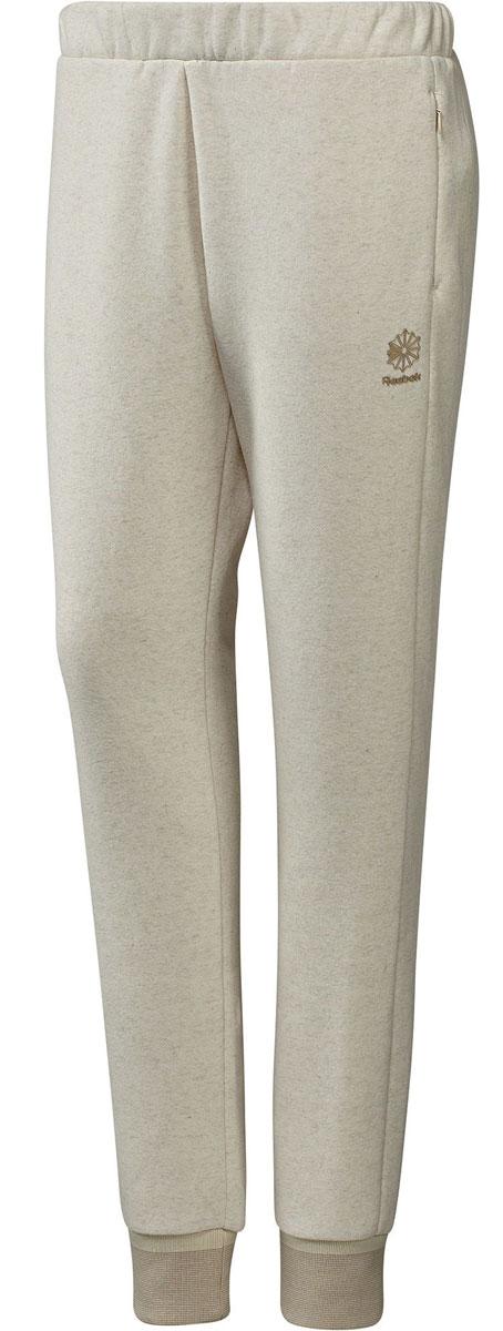 Брюки спортивные женские Reebok F Fleece Pant, цвет: бежевый. BK2516. Размер S (42/44)BK2516Спортивные женские брюки Reebok F Fleece Pant - основа вашего гардероба. Мягкие спортивные брюки, в которых стиль идеально сочетается с комфортом. Они сделаны из органического хлопка и переработанного полиэстера. А в удобные карманы на застежках-молниях поместятся необходимые мелочи. Облегающий крой отлично подходит для тренировок и придает стилю эффектности.Манжеты по низу штанин отделаны трикотажем в рубчик для оптимальной посадки и комфорта.Пояс на шнурке для надежной посадки.