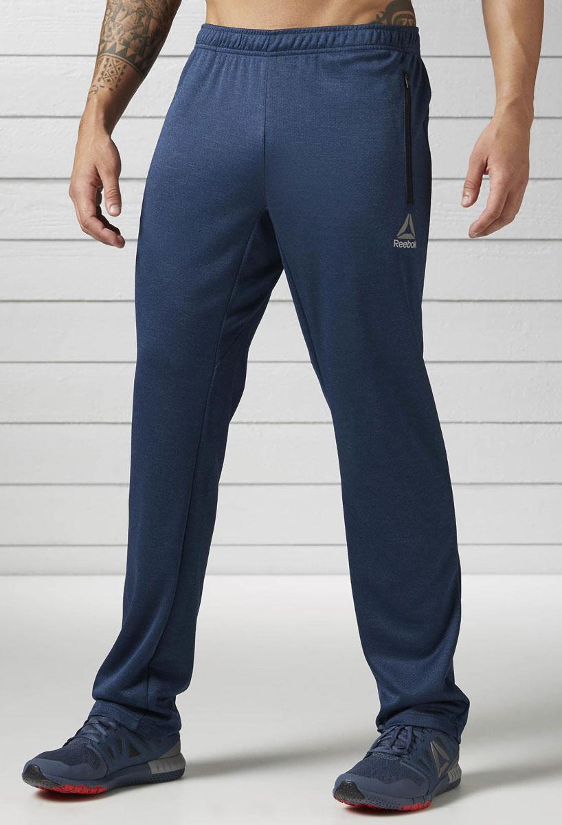 Брюки спортивные мужские Reebok Wor Elitage Group O, цвет: синий. BK3305. Размер S (44/46)BK3305Спортивные мужские брюки Reebok Wor Elitage Group O - легкая и удобная модель. Мягкие брюки, в которых удобно и тренироваться, и отдыхать. Отлично подходят для тренировок и повседневной носки. Технология Speedwick отводит влагу с поверхности тела, оставляя ощущение сухости и комфорта. Комфортная посадка для полной свободы движений и боковые карманы на застежках-молниях для хранения мелочей.Пояс на шнурке для оптимальной посадки.
