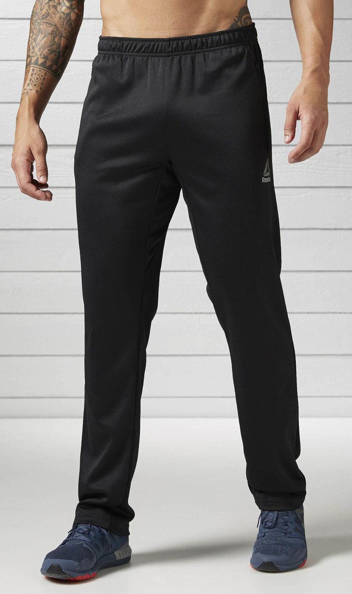 Брюки спортивные мужские Reebok Wor Elitage Group O, цвет: черный. BK3316. Размер M (48/50)BK3316Спортивные мужские брюки Reebok Wor Elitage Group O - легкая и удобная модель. Мягкие брюки, в которых удобно и тренироваться, и отдыхать. Отлично подходят для тренировок и повседневной носки. Технология Speedwick отводит влагу с поверхности тела, оставляя ощущение сухости и комфорта. Комфортная посадка для полной свободы движений и боковые карманы на застежках-молниях для хранения мелочей.Пояс на шнурке для оптимальной посадки.