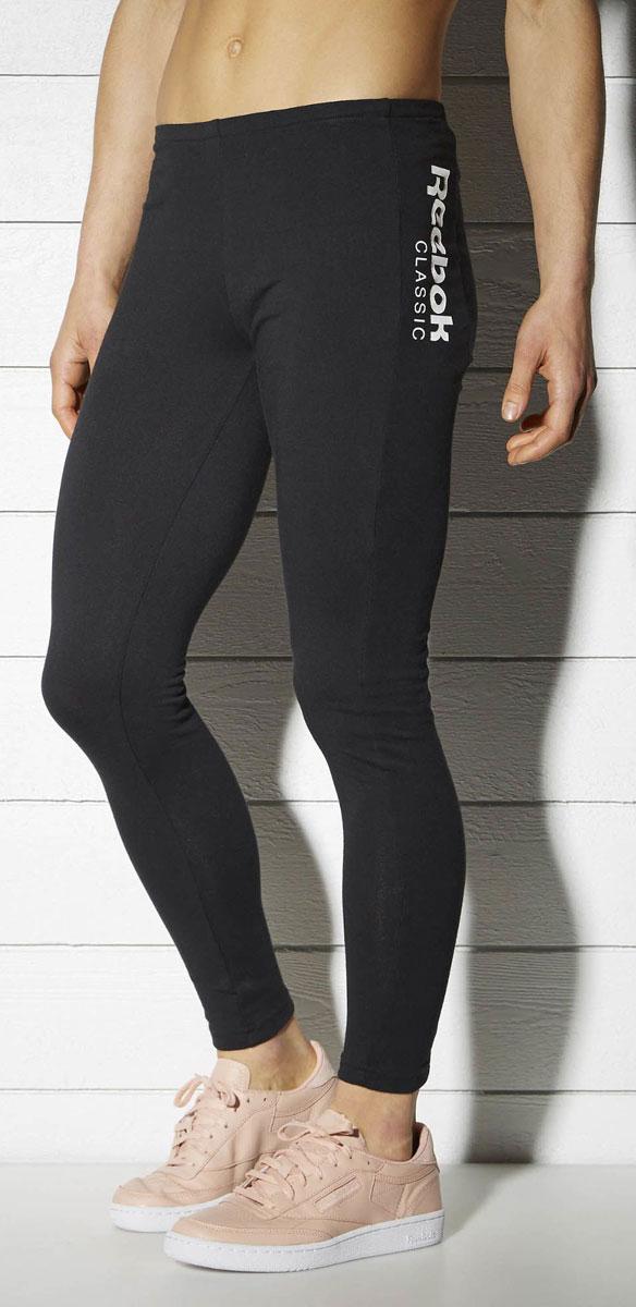 Леггинсы женские Reebok F Fitness Leggings, цвет: черный. BK4150. Размер L (50/52)BK4150Леггинсы Reebok F Fitness Leggings выполнены из высококачественного материала. Модель с контрастными деталями идеально дополнит ваш фитнес-гардероб. Леггинсы слегка укороченного кроя дополнены эластичным поясом для идеальной посадки и оформлены логотипом Reebok Classic.