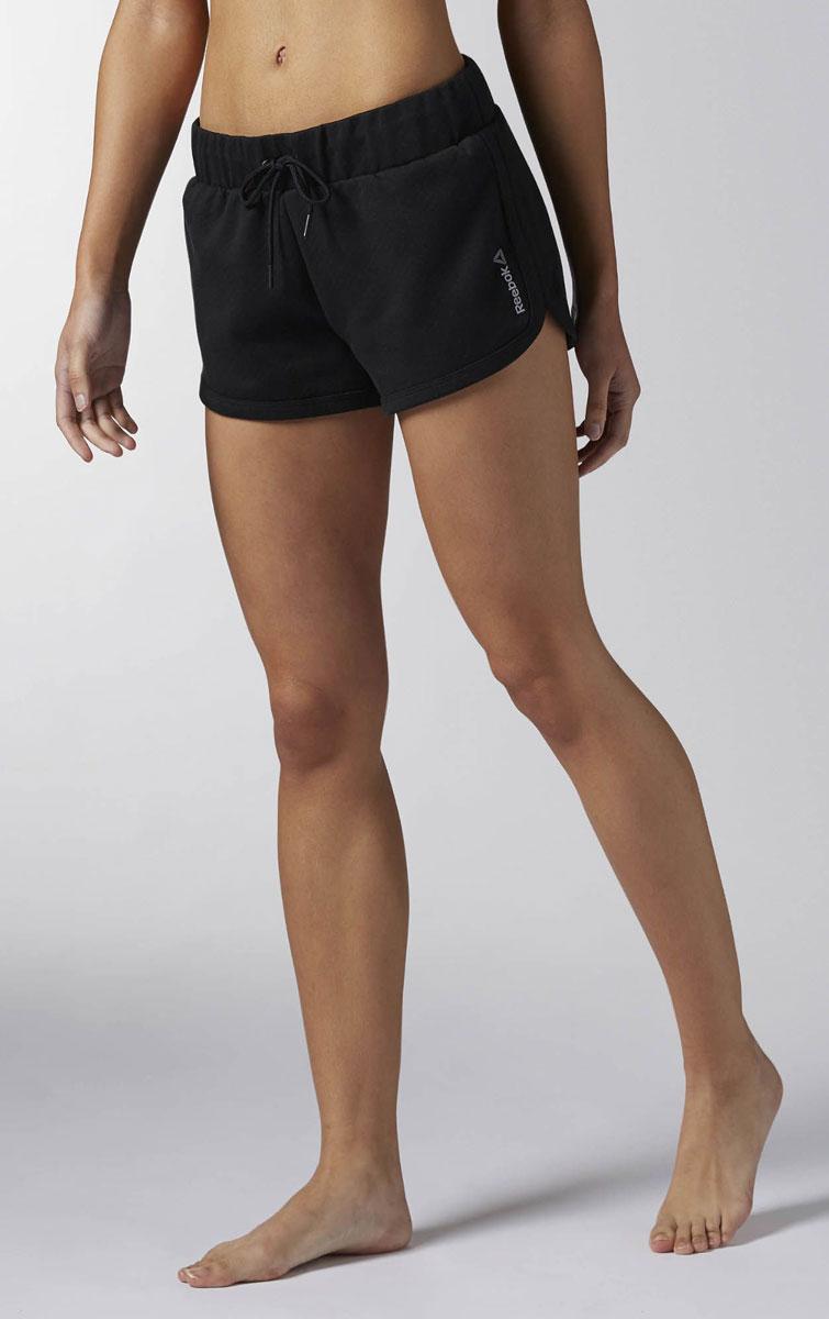 Шорты женские Reebok Wor Cs Shorts, цвет: черный. BK3148. Размер S (42/44)BK3148Женские шорты Reebok Wor Cs Shorts выполнены из легкого материала, дышащего материала. Отлично подойдут и для интенсивной тренировки, и для ежедневной носки. Технология Speedwick отводит влагу с поверхности тела, оставляя ощущение сухости и комфорта. Пояс на шнурке для оптимальной посадки. Боковые карманы отлично подходят для хранения мелочей.