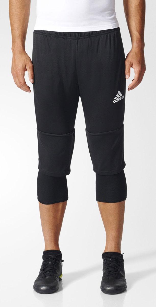 Брюки спортивные мужские adidas Tiro17 3/4 Pnt, цвет: черный. AY2879. Размер XL (56/58)AY2879Брюки спортивные мужские adidas Tiro17 3/4 Pnt выполнены из 100% полиэстера. Сшиты из эластичной ткани, которая обеспечивает полную свободу движений во время приседаний и выпадов. Легкая модель дополнена внутренними шортами для повышенного комфорта и карманами на молнии для хранения полезных мелочей. Эластичный пояс на регулируемых завязках-шнурках.
