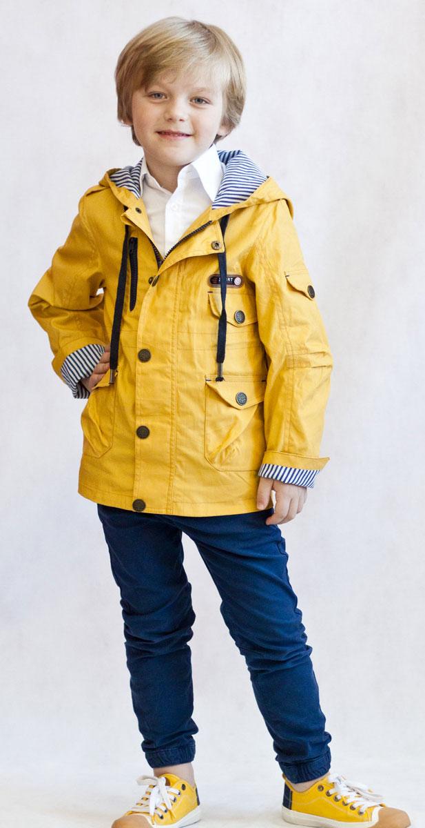 Ветровка для мальчика OLDOS Назар, цвет: горчичный. 3К1707-2. Размер 146, 11 лет3К1707Легкая стильная ветровка Назар от Oldos идеальна для прохладной погоды с температурой +10…+20°С. Внешняя ткань из хлопка с водоотталкивающей пропиткой защищает от ветра и дождя. Принтованная подкладка из бязи приятна на ощупь. Модель застегивается на молнию. Ветрозащитная планка по всей длине молнии закрывается на кнопки. Ветровка оснащена несъемным капюшоном, объем которого можно отрегулировать. Рукава модели прямые, с декоративным отворотом. Талия куртки снабжена внутренней регулируемой утяжкой для идеальной посадки. Также ветровка оснащена вместительными накладными карманами с клапанами на кнопках и светоотражающими элементами для безопасных прогулок в темное время суток.